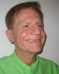 Gary, middleaged man with short reddish brown hair smiling broadly